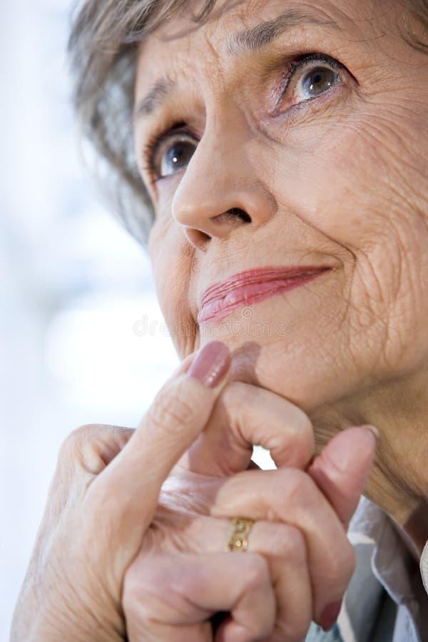 Close up face of senior woman thinking royalty free stock photos