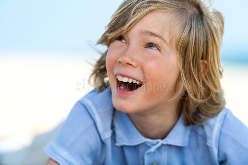 Close up face shot of happy boy outdoors. stock photography