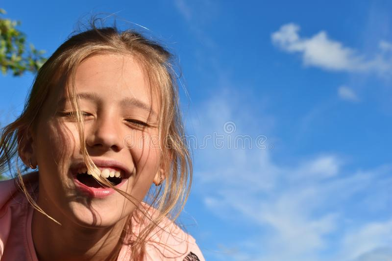 Beautifulgirl on background of clear blue sky in the summer royalty free stock photography