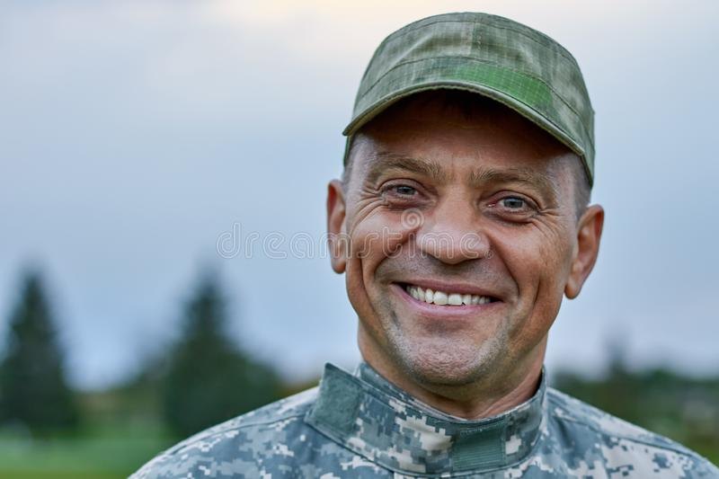 Close up face of a smiling mature soldier. royalty free stock photography