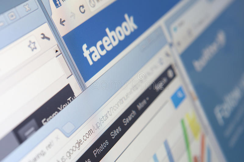 Close up of facebook and other windows screenshot stock photography