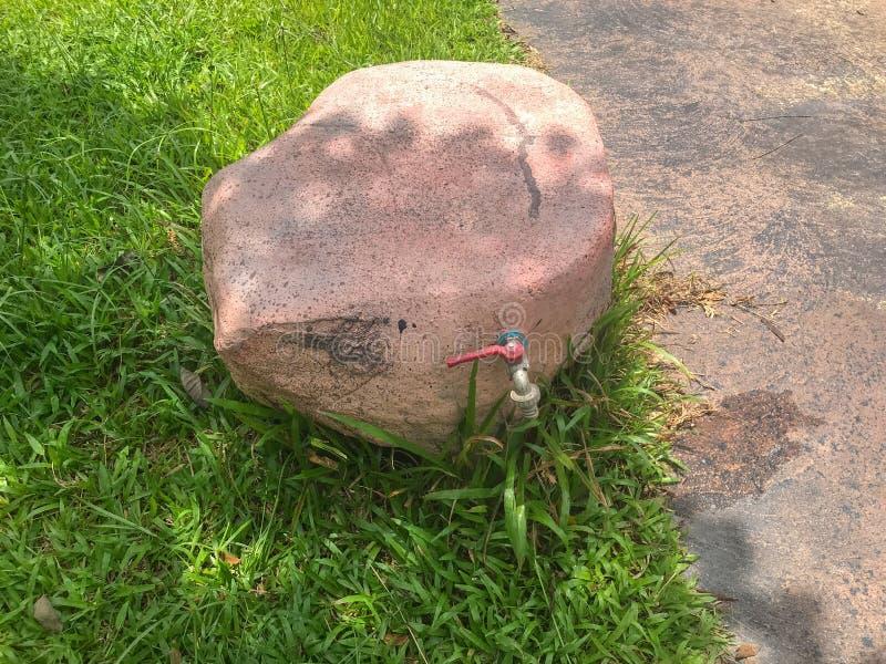 Fake stone faucet at national park at Phatthalung, Thailand. Close up of fake stone faucet at national park at Phatthalung, Thailand stock photos