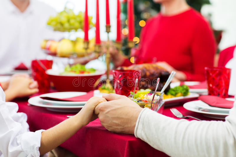 Close up of family having christmas dinner at home royalty free stock images