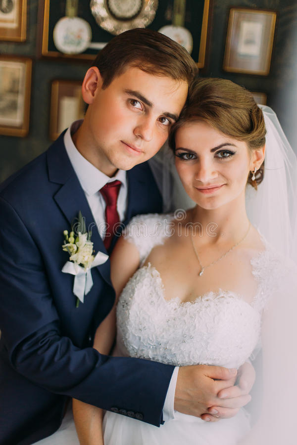 Close-up family photo of bride and groom posing in restaurant royalty free stock photo