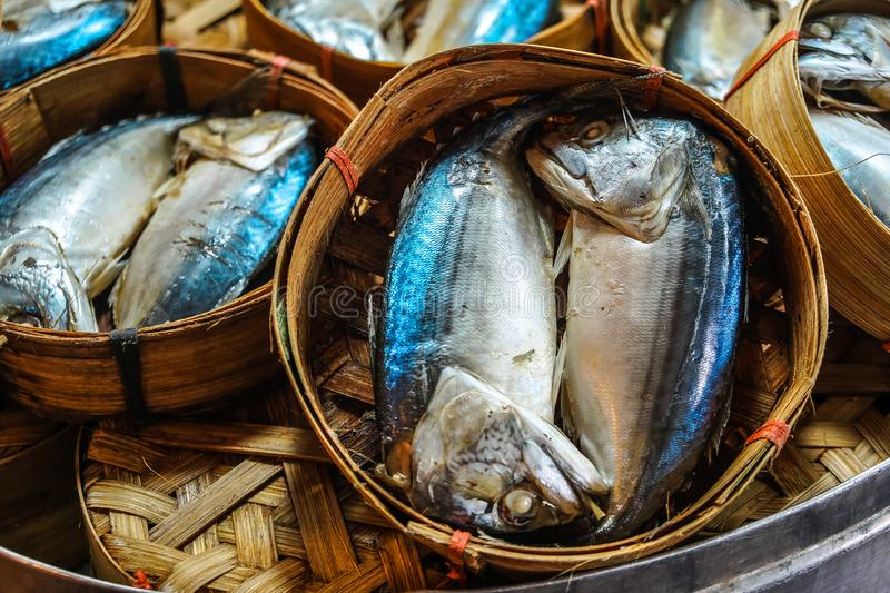 Close up The famouse Thai traditional Steamed mackerel fish in basket bamboo or wicker basket in thailand market.  stock image
