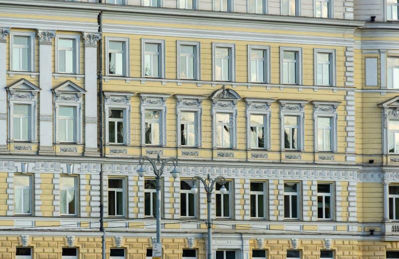 Close-up of fasade details on beautiful building Hotel Baltschug Kempinski Raushskaya Embankment from park Zaryadye stock images