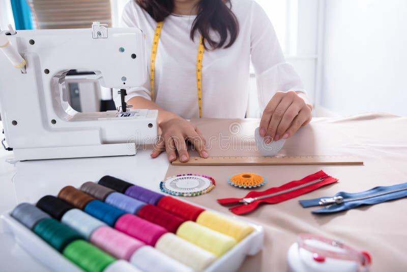 Fashion Designer Measuring Fabric With Ruler stock photos