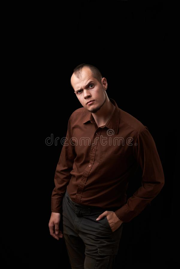 Close up Fashion Shot of a Young Man A trendy European man dressed in contemporary cloth. Portrait of a nice guy stock photo