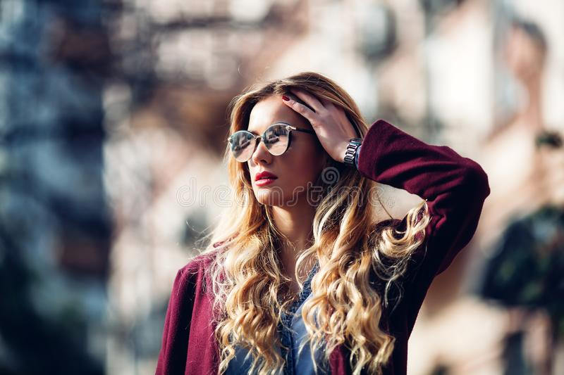 Close up fashion street stile portrait of pretty girl in fall casual outfit Beautiful blond posing outdoor. royalty free stock photo
