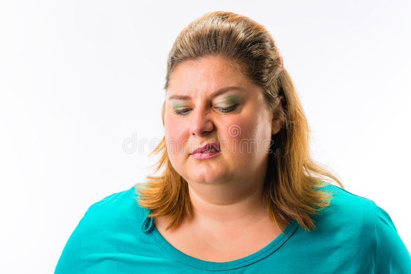 Close-up of fat annoyed woman royalty free stock images