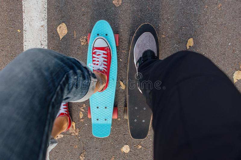 Close up of feet on penny skate board. stock images