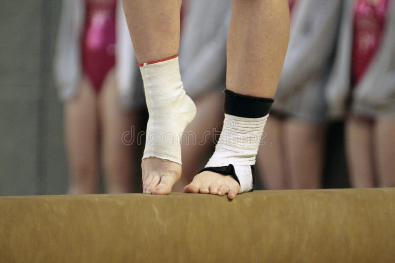 Close up of feet of a gymnast on a beam stock images