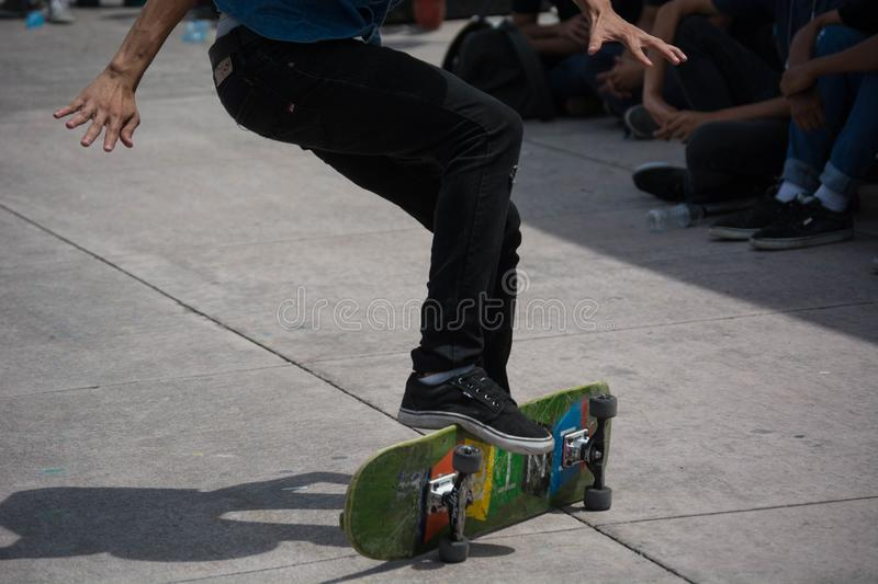 Close up at the feet of a young boy doing skateboard tricks. OHIO, UNITED STATES - Aug 08, 2019: Close up at the feet of a boy doing some skateboard tricks stock photos