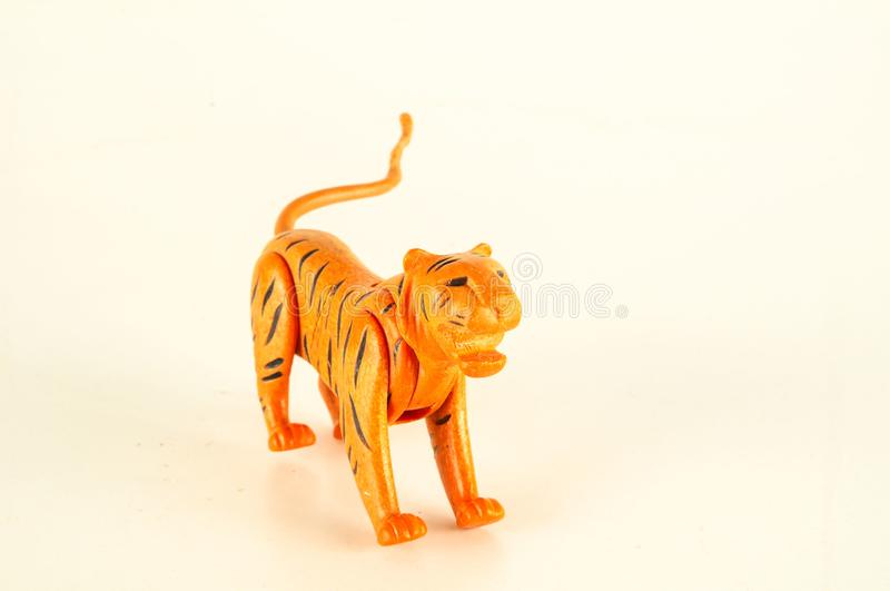Close-up of feline cat lion plastic animal. Object on a White Background royalty free stock photography