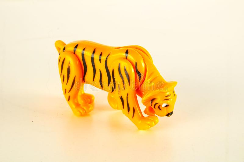 Close-up of feline cat lion plastic animal. Object on a White Background stock photo