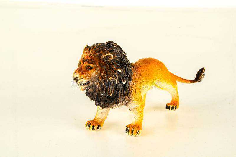 Close-up of feline cat lion plastic animal. Object on a White Background stock image