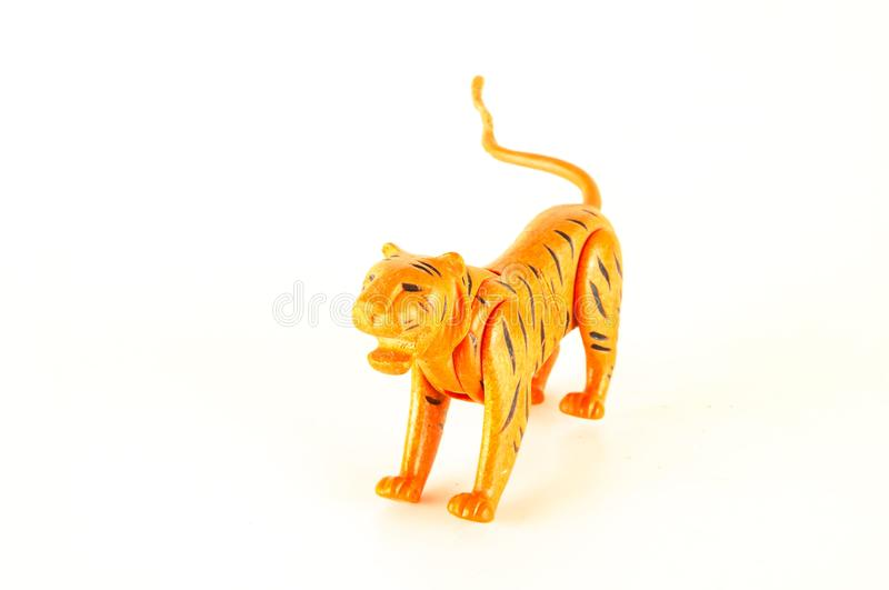 Close-up of feline cat lion plastic animal. Object on a White Background royalty free stock photo