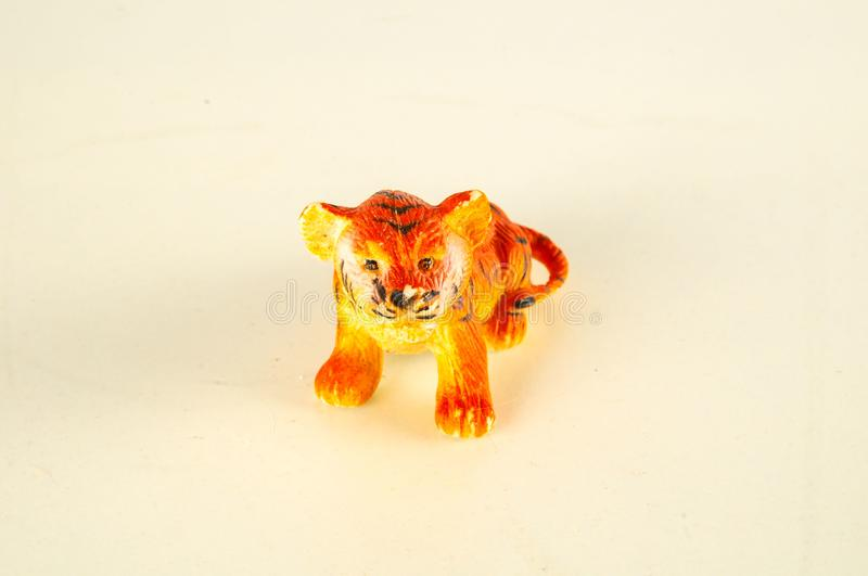Close-up of feline cat lion plastic animal. Object on a White Background royalty free stock images