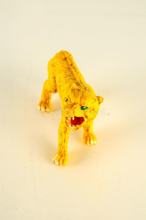 Close-up of feline cat lion plastic animal. Object on a White Background royalty free stock image