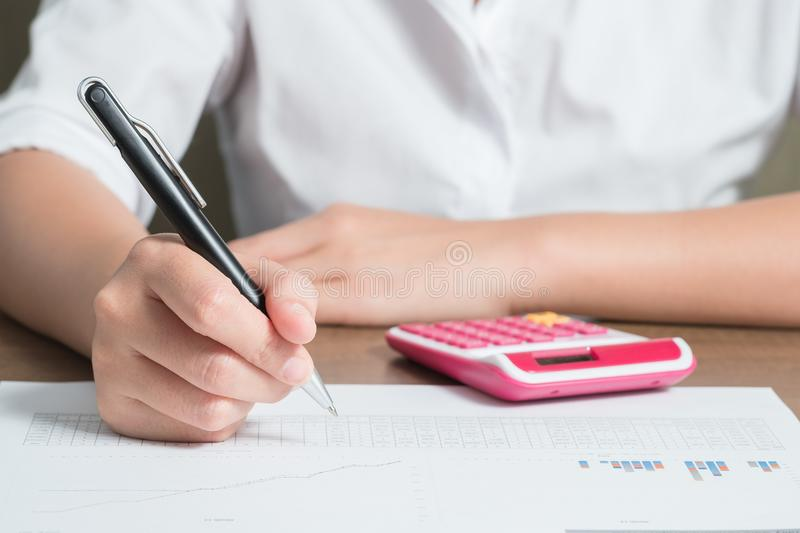 Close up female accountant or banker making calculation stock images