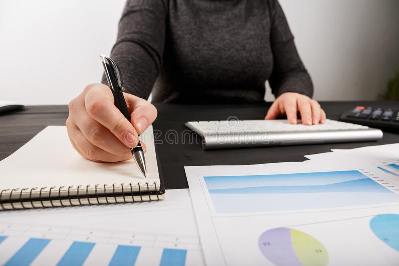Close up of female accountant or banker making calculations. royalty free stock photos