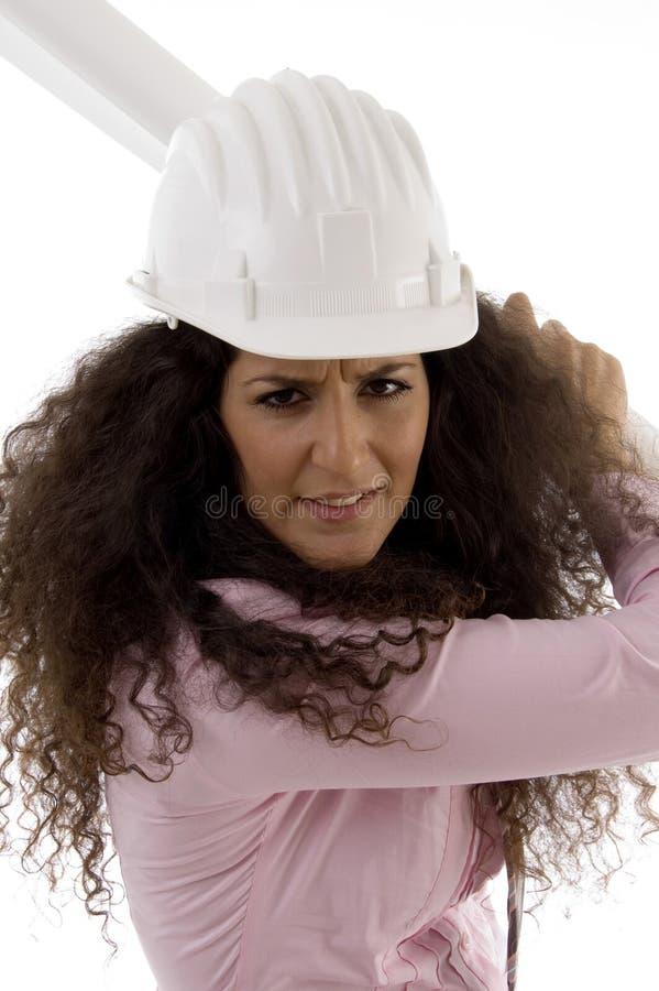 Close up of female architect holding blueprints