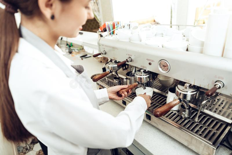 Close up of female barista preparing coffee royalty free stock images