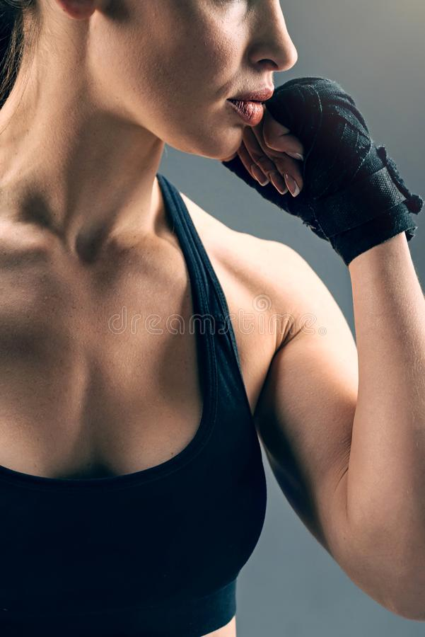 Close up of female boxer wearing black wrist wraps stock photography