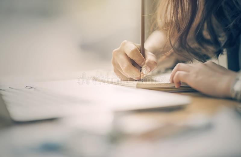 Close up of female designer hands drawing something stock image