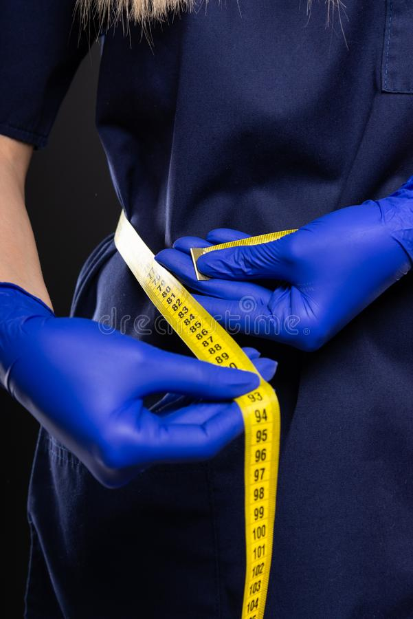 Close-up of female doctor making measuring herself stock image