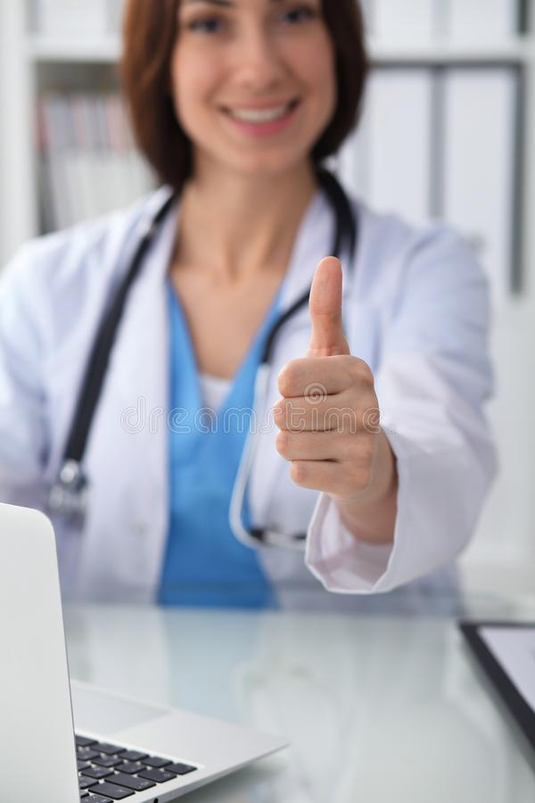 Close up of female doctor thumbs up. Happy cheerful smiling brunette physician ready to examine patient. Medicine. Healthcare and help concept stock photos