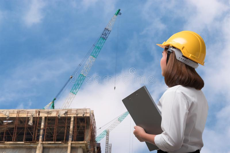 Close up female engineer wearing safety helmet in construction site stock photos