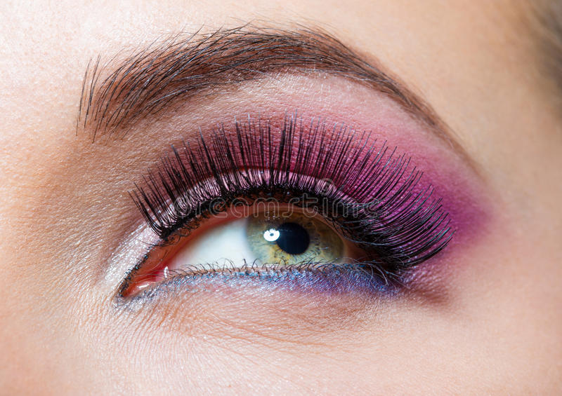 Close Up Of Female Eye With Brilliant Pink Makeup Stock