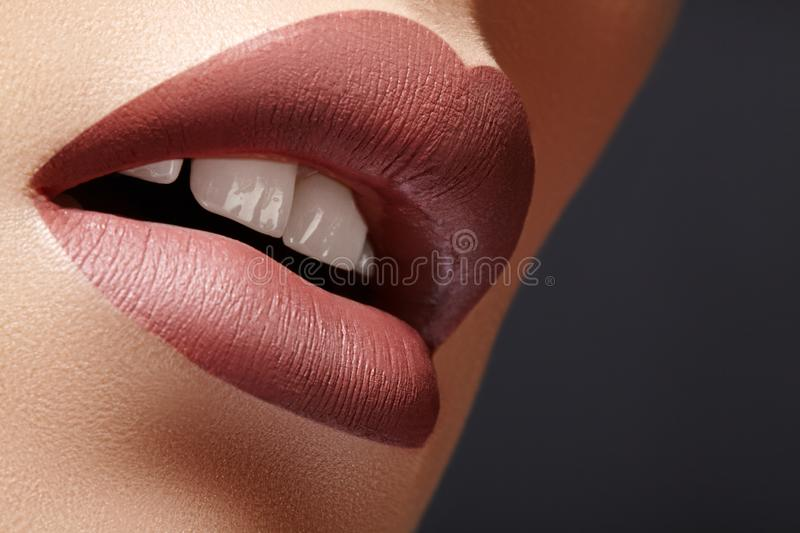 Close-up Female Lips with Fashion Natural coffee Lipstick Makeup. Macro Sexy Lip Stick Make-up. Mat Fashionable Style stock images