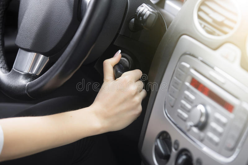 Close-up of female hand adjusting a rear-view mirror royalty free stock photography