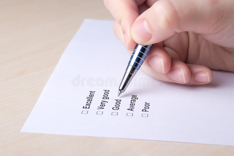 Close up of female hand filling customer survey royalty free stock images
