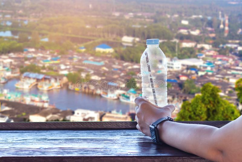 Close up female hand holding a bottle of water royalty free stock images