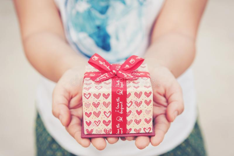 Close up female hand holding a small gift heart pattern. With re royalty free stock images