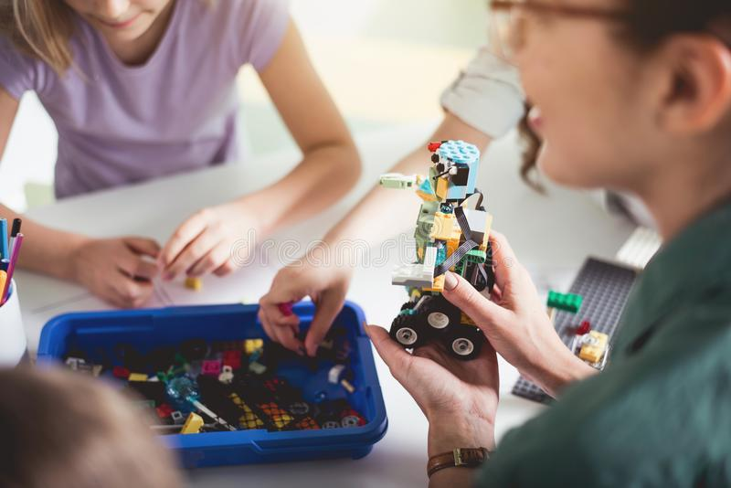 Woman arm holding plastic toy stock image
