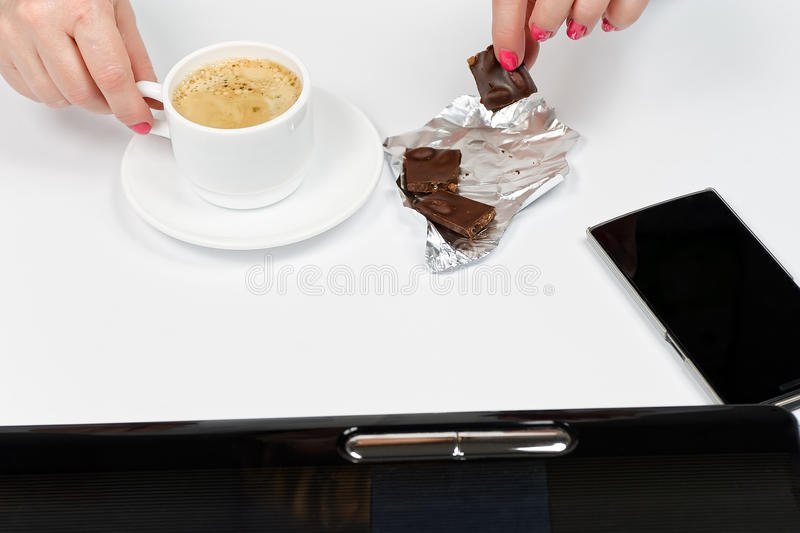 Close-up of female hands with laptop and coffee stock photo