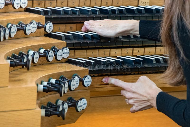 Close-up of female hands playing a Pipe Organ. royalty free stock images