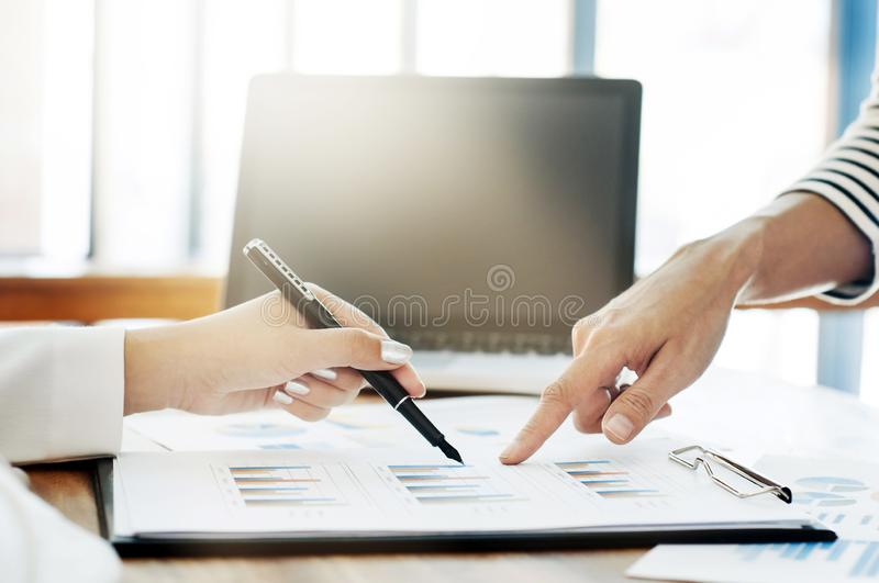 Close-up of female hands pointing at business document while discussing at meeting stock photography