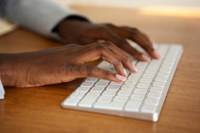 Close up female hands typing on computer keyboard royalty free stock photos