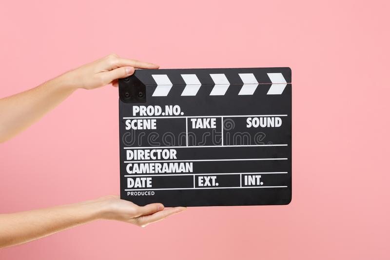 Close up female holding in hand classic director clear empty black film making clapperboard isolated on trending pastel royalty free stock images