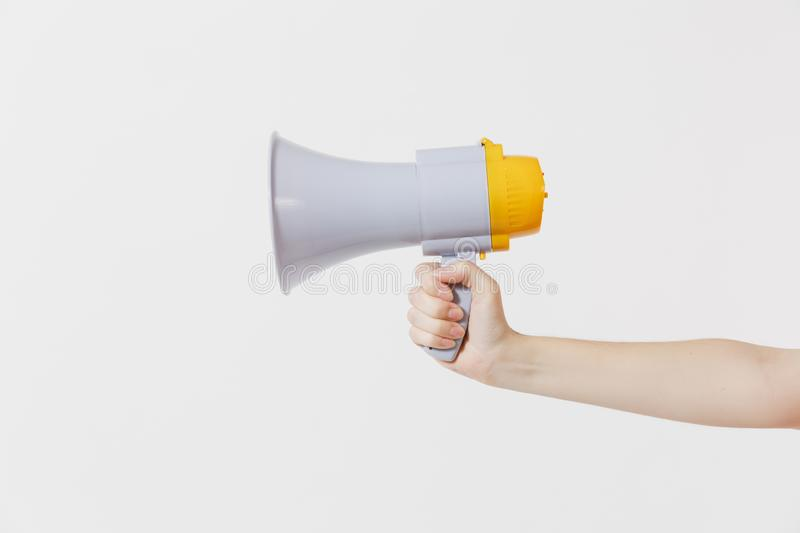 Close up female holds in hand bullhorn public address megaphone isolated on white background. Hot news, announce royalty free stock photos