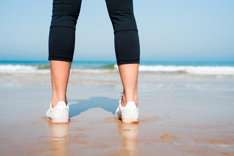 Close up of a female jogger on the beach royalty free stock images