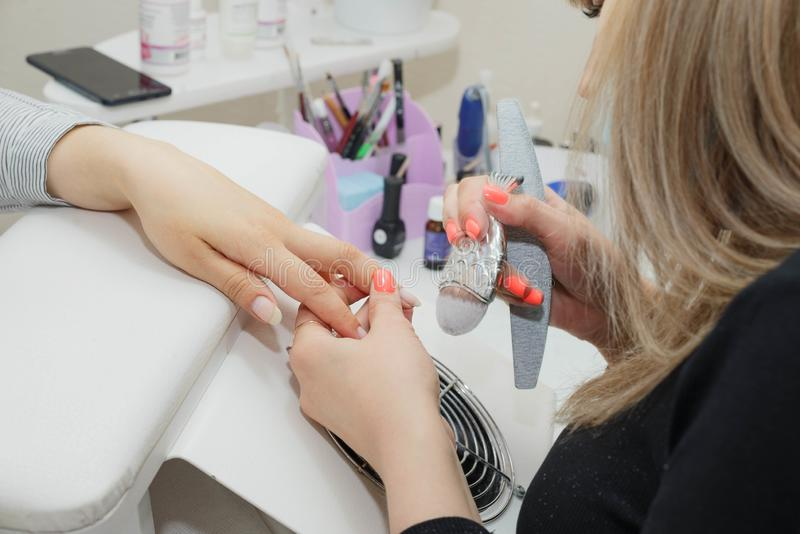 Close-up Of A Female Manicurist Doing Person`s Nails In Salon. Cleaning Nails With Brush stock photos