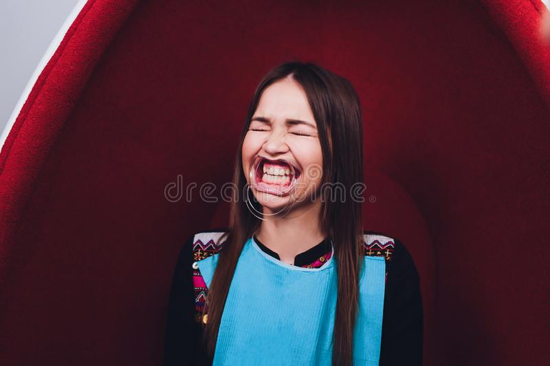 Close up of female mouth with retractor. Doctor flossing the teeth. Dental Gag. Close up of female mouth with retractor. Doctor flossing the teeth. Dental Gag stock image