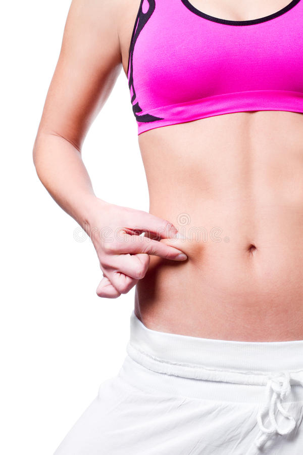 Close-up of female pinching skin of her belly. Isolated royalty free stock images