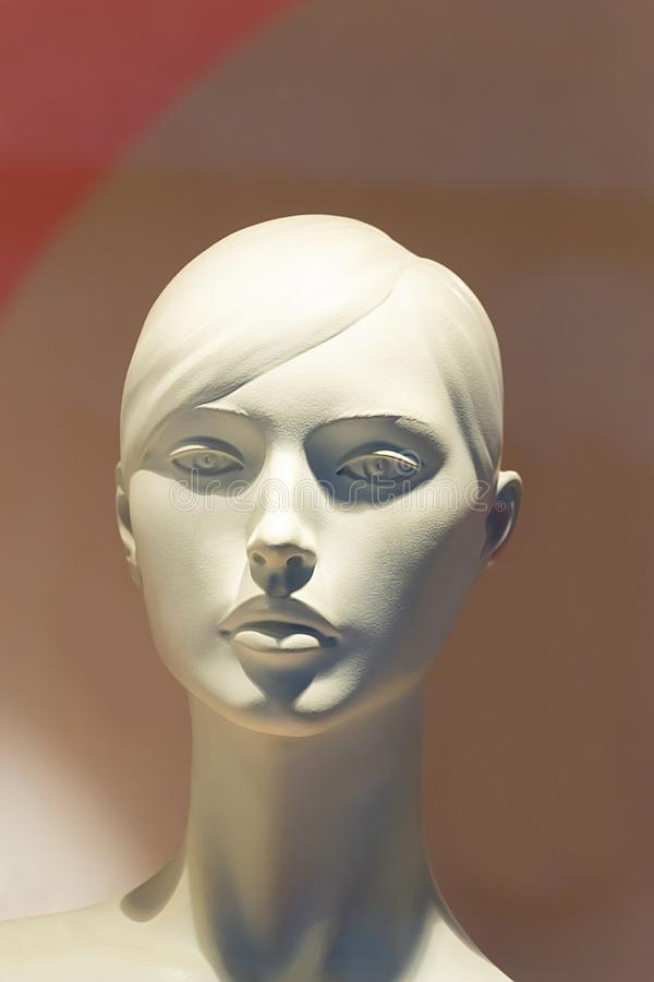 Close-up of a female plastic mannequin head with a pretty face royalty free stock image